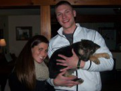 Couple with their German Shepherd puppy