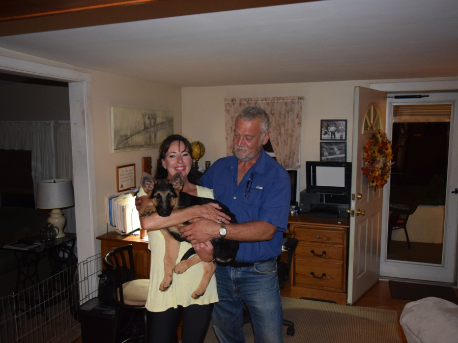 Couple with their new German Shepherd puppy