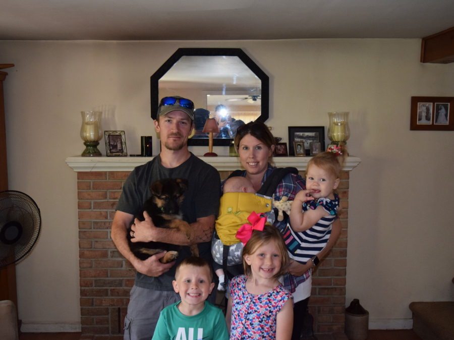 Family with their new German Shepherd puppy